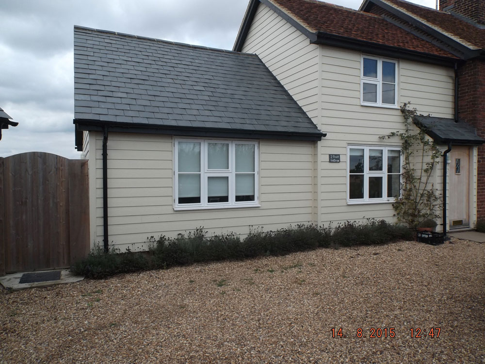 Two storey and single storey extension finished in weatherboarding
