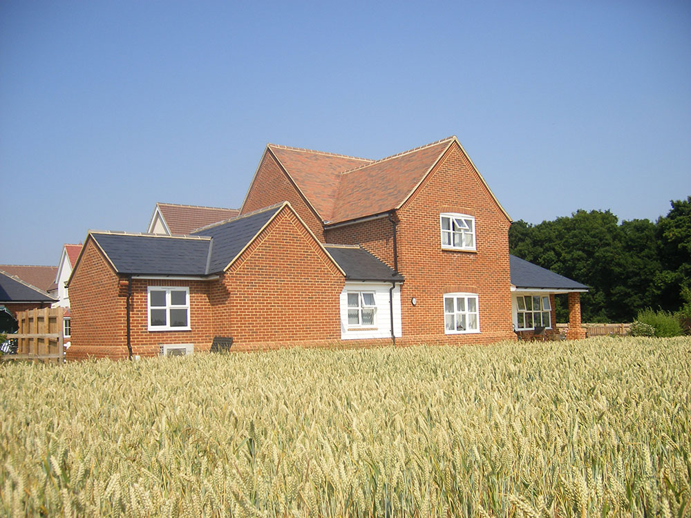 Dual aspect windows to the living room benefit from countryside views.
