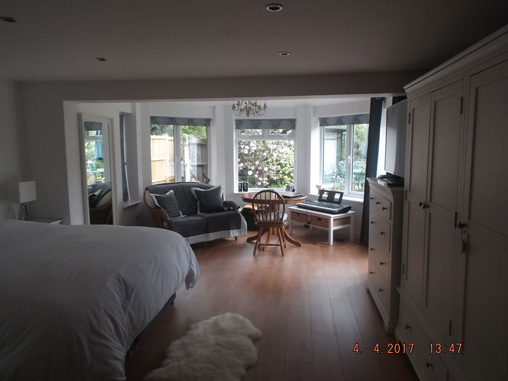 Conservatory and office replaced with large ground floor bedroom, en suite and sitting area overlooking the garden.