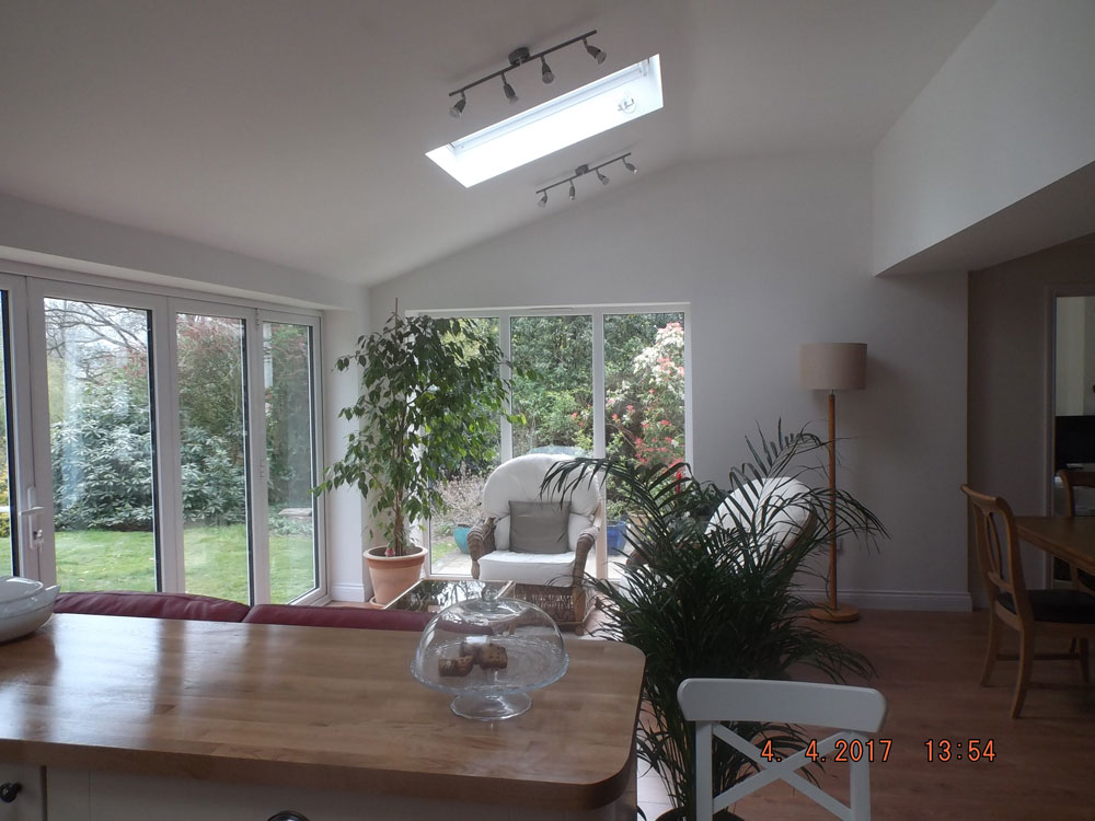 Open plan kitchen and dining extension with vaulted ceiling, roof lights and aluminium bi-folding doors.