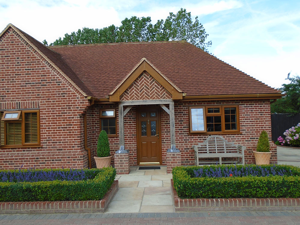 Annexe front entrance with porch supported on brickwork piers and oak posts