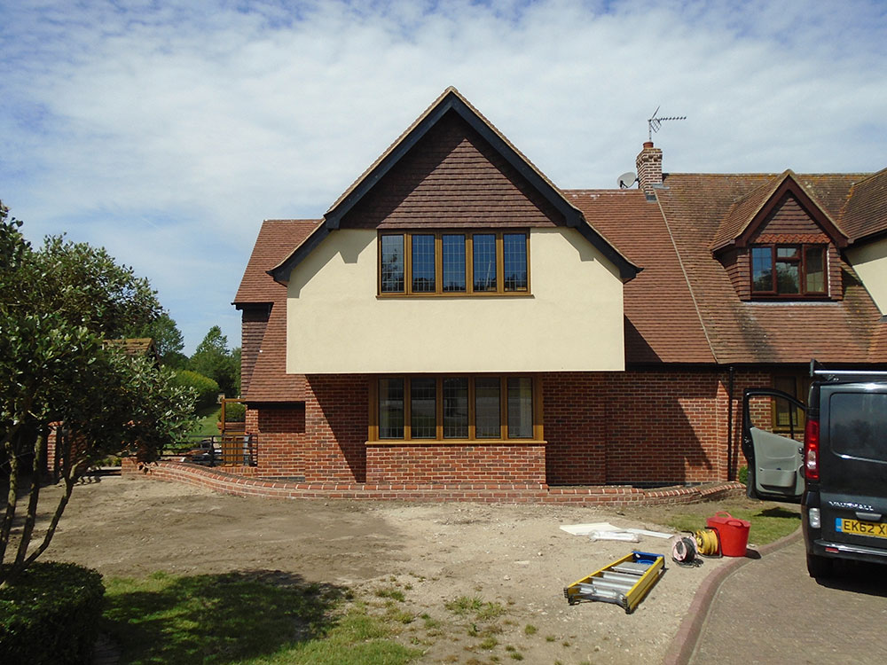 Front two storey extension with bay window and jettied first floor gable end