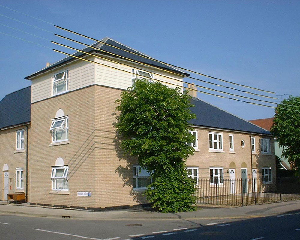 Three storey element accommodating offices with a mix of apartments and housing either side.